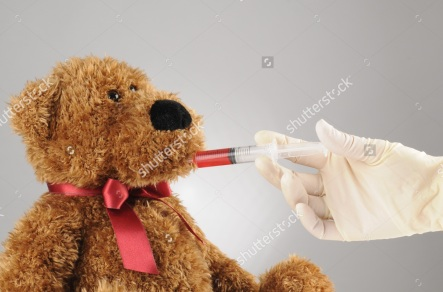 stock-photo-a-sick-teddy-bear-getting-liquid-medicine-in-the-hospital-8972491.jpg